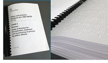 Cover of Braille edition of the police and criminal evidence act code of practice, code C, and close up of braille on a page of the document when opened.